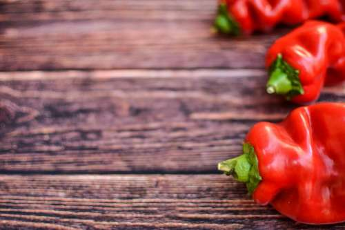 Red peppers on wood