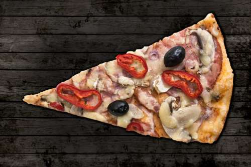 Slice of pizza on wooden background