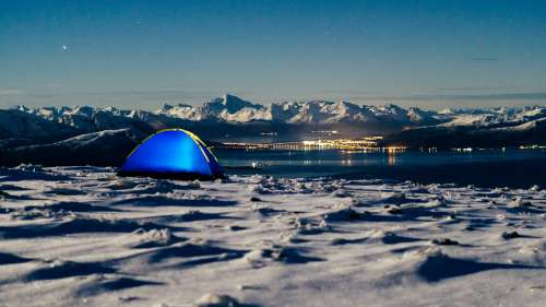 Camping Place on Snowy Mountain with Fjord View