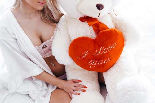 Happy Woman with Big Teddy Bear on Valentine's Day