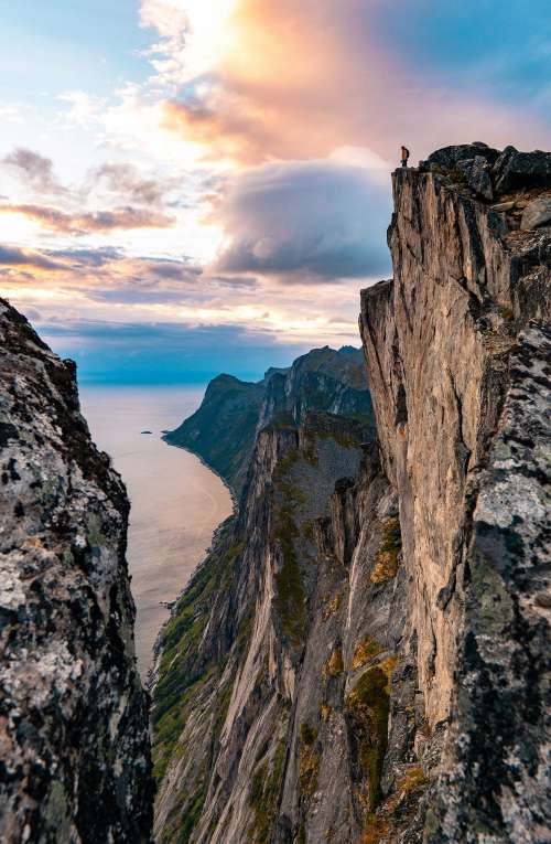 Man Standing on the Edge of the Cliff on Senja Island