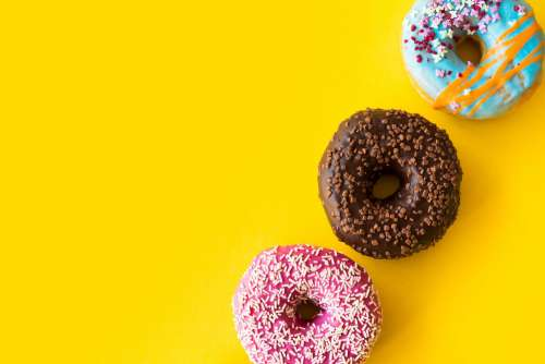 Yummy Donuts on Yellow Background
