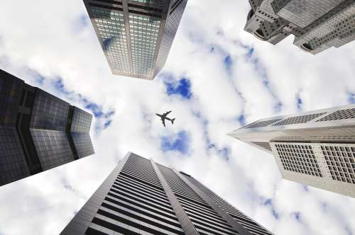 Airplane Sky Buildings Towers Architecture City