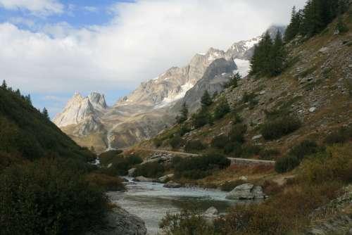 Alps Stream Mountains Snow Caps Valley