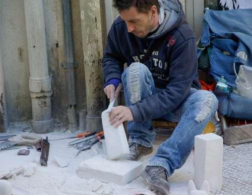 Artisan Stonecutter Sculpture