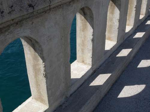 Bridge Shadow Light Blue Water Arches