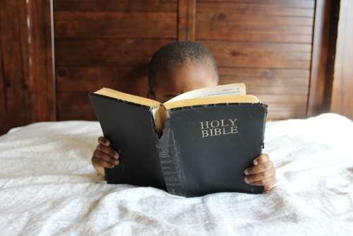 Child Reading Bible Bed African Education Boy