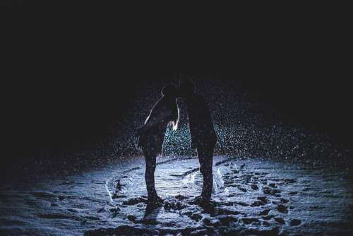 Couple Kissing Snowy Night Snowing Headlights Night