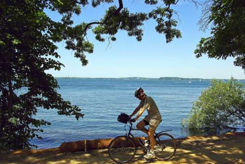 Cyclist On Lakeshore Path Bicycle Trail Cycling