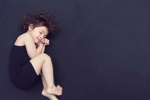 Girl Curled Up Sleeping Asleep Comfortable Child