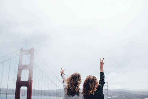 Golden Gate Bridge Women Back Looking Peace Sign