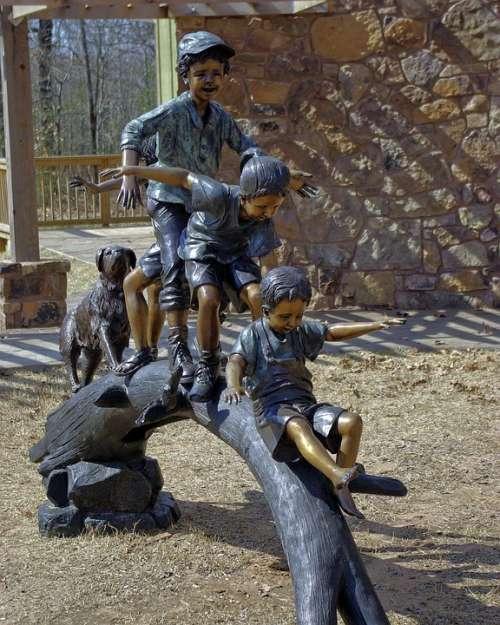 Kids Playing On Log Sculpture Art Statue Figure