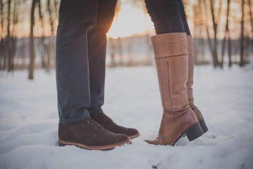 Kissing Couple Man Feet Boots Snow Sunset