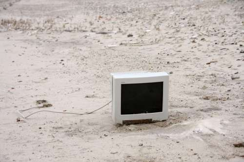 Monitor On The Beach Washed Up On Beach Screen