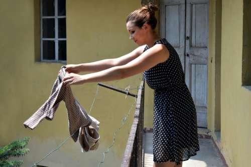 Roll Out Cloths Railing Balcony Girl Woman
