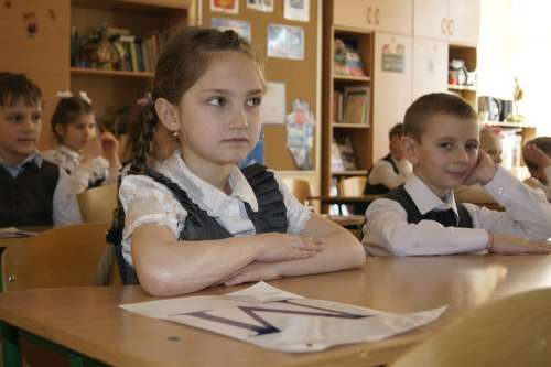 Schoolboy At The Desk Sitting