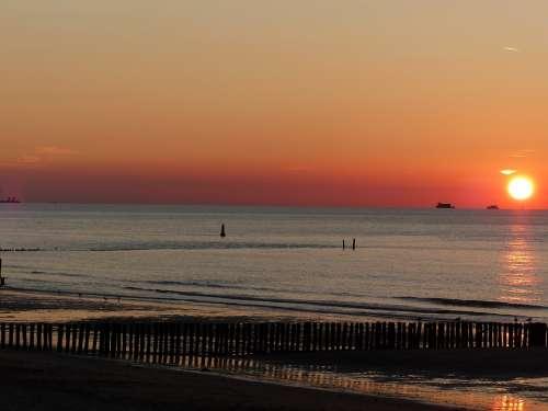 Sun Sinking In The Sea Mood Sunset
