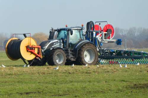 Tractor Manure Spreading Injecting Ground