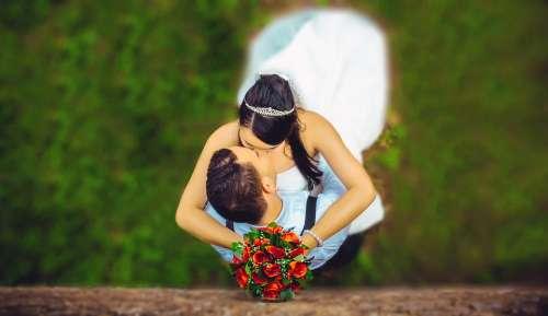 Wedding Couple Kissing Embrace Hugging Together