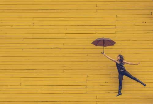 Woman Umbrella Floating Jumping Yellow Background