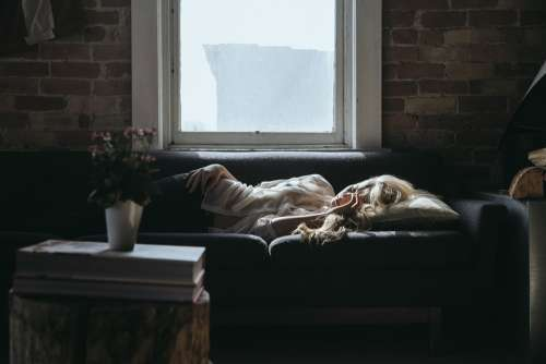 Woman Sleeping Sofa Home Relaxing Break Interior