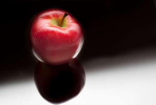Shiny apple on black background