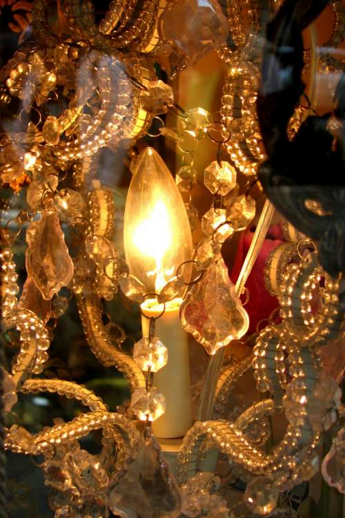 chandelier closeup with candle-flame bulb