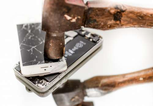 Smashing a phone with a hammer