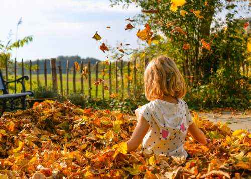 Girl playing with leaves