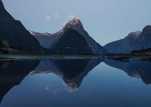 Mountains Reflect On Water Creating Two Worlds Photo