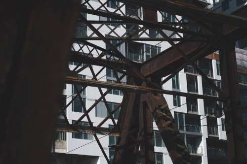 Rusted Steel Bridge And Condo Building Photo