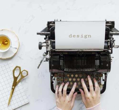 Teatime Design Flat Lay With Typewriter Photo