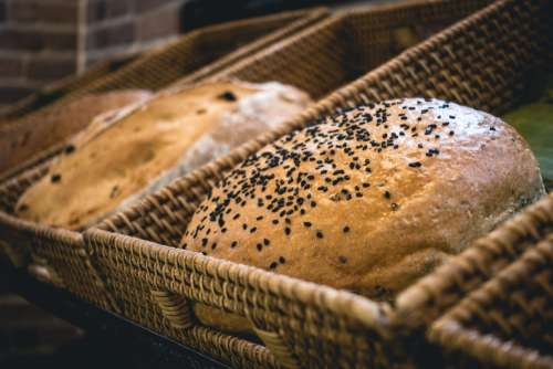 Loaf of bread with black sesame seeds in a bakery