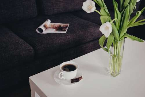 Cup of coffee and tulips on the table