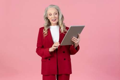 Old Woman Holding Digital Tablet