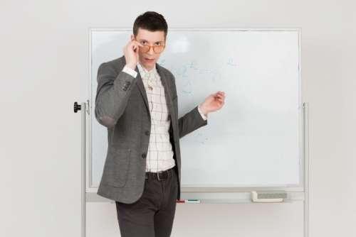 Young Teacher Adjusting His Eyeglasses