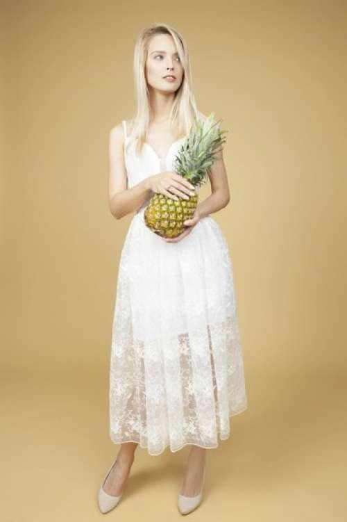 Beautiful Bride Holding A Pineapple