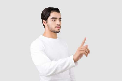 Attractive Young Man Pointing With A Finger
