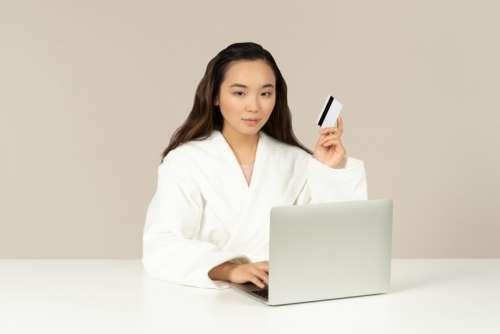 Young Asian Woman Doing Online Shopping