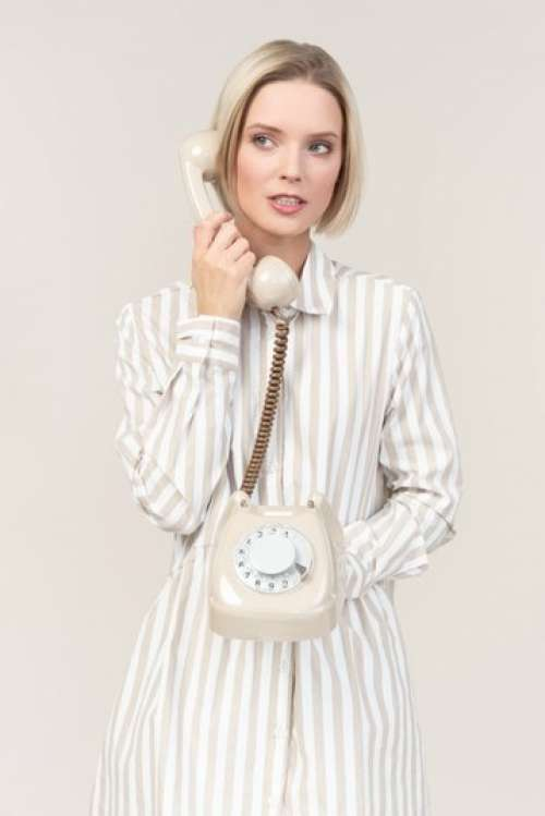Young Woman Talking On The Old Rotary Phone