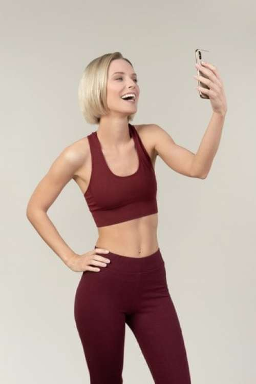 Laughing Young Woman Making A Selfie