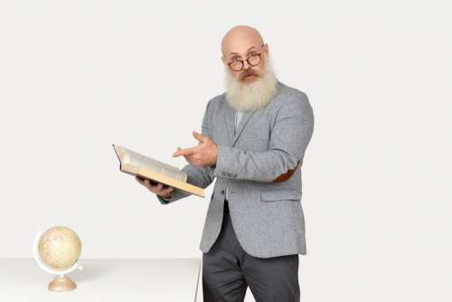 Surprised Looking Old Professor Holding A Book