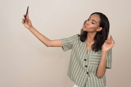 Young Attractive Woman Taking A Selfie