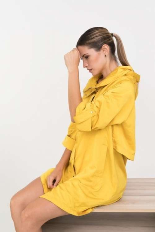Young Woman In A Yellow Rain Jacket