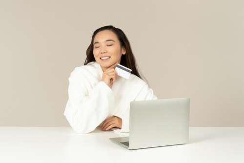 Smiling Young Asian Woman Doing Online Shopping