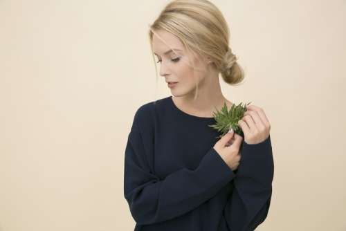 Young Woman Holding A Prickle On Her Shoulder