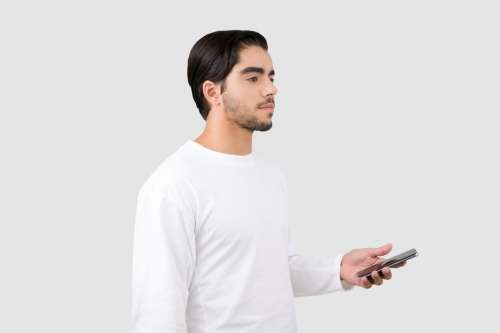 Handsome Young Man Holding A Phone