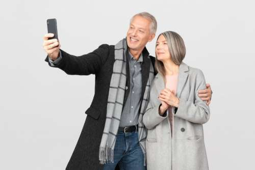 Middle Aged Couple Making A Selfie With Smartphone