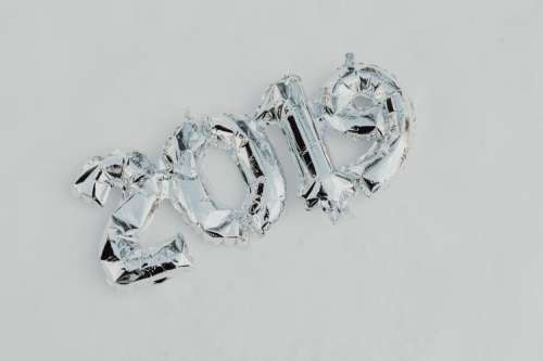 Silver balloons in shape of New Year of 2019