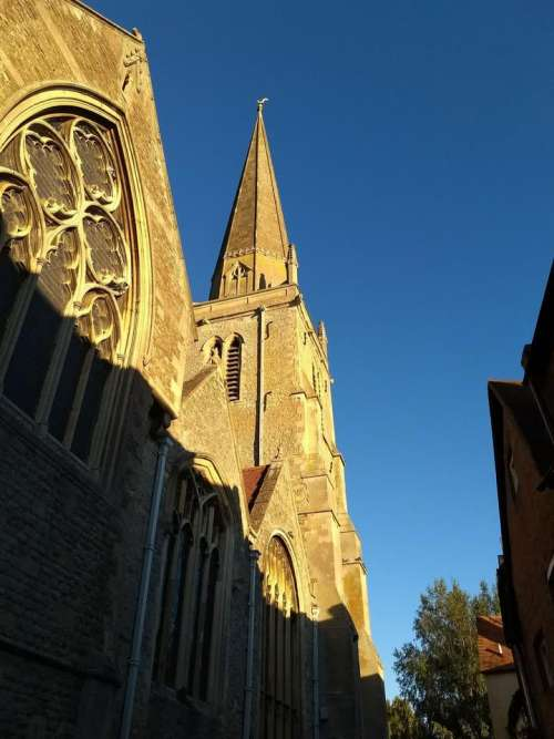 church spire tower morning sun
